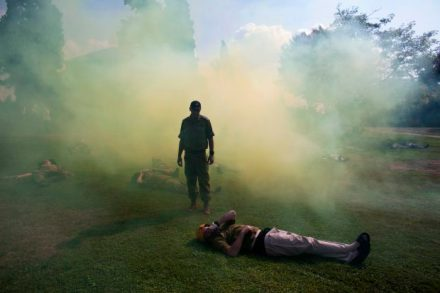 Israeli soldiers role playing as mock victims lie on the ground during a drill simulating a missile attack in Holon